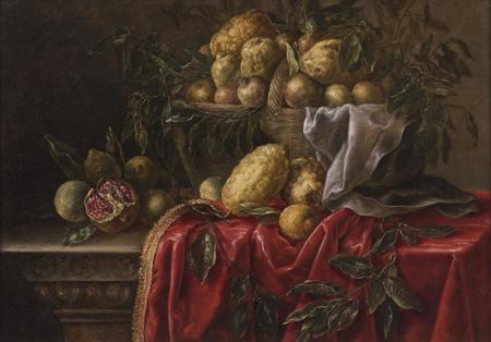Zátiší s citrusovými plody a granátovými jablky v proutěném koši